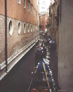 gondolas on a narrow canal